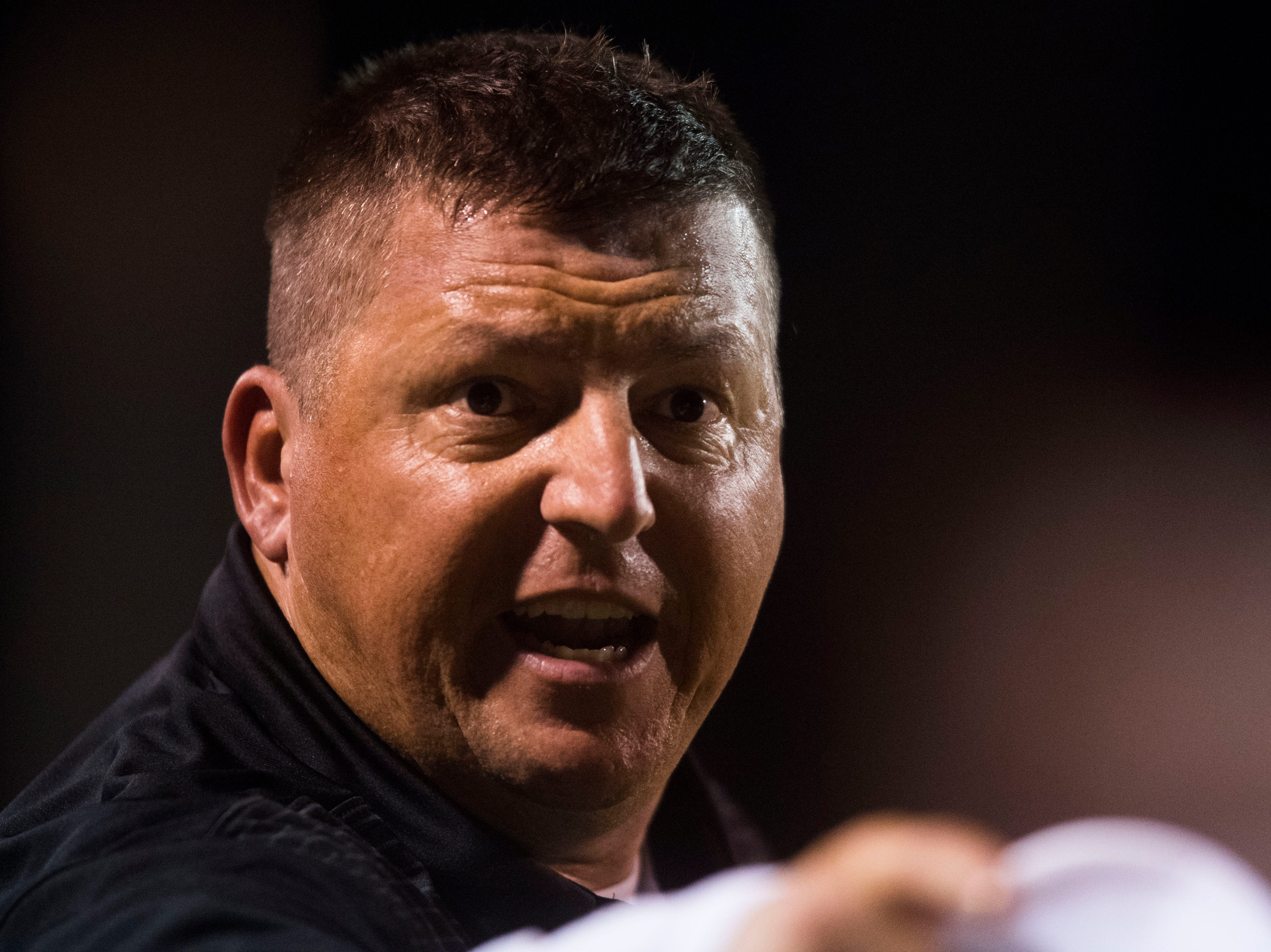 Powell head coach Matt Lowe speaks with an official during a game between Oak Ridge and Powell at Oak Ridge Friday, Oct. 19, 2018. Oak Ridge defeated Powell 28-21.