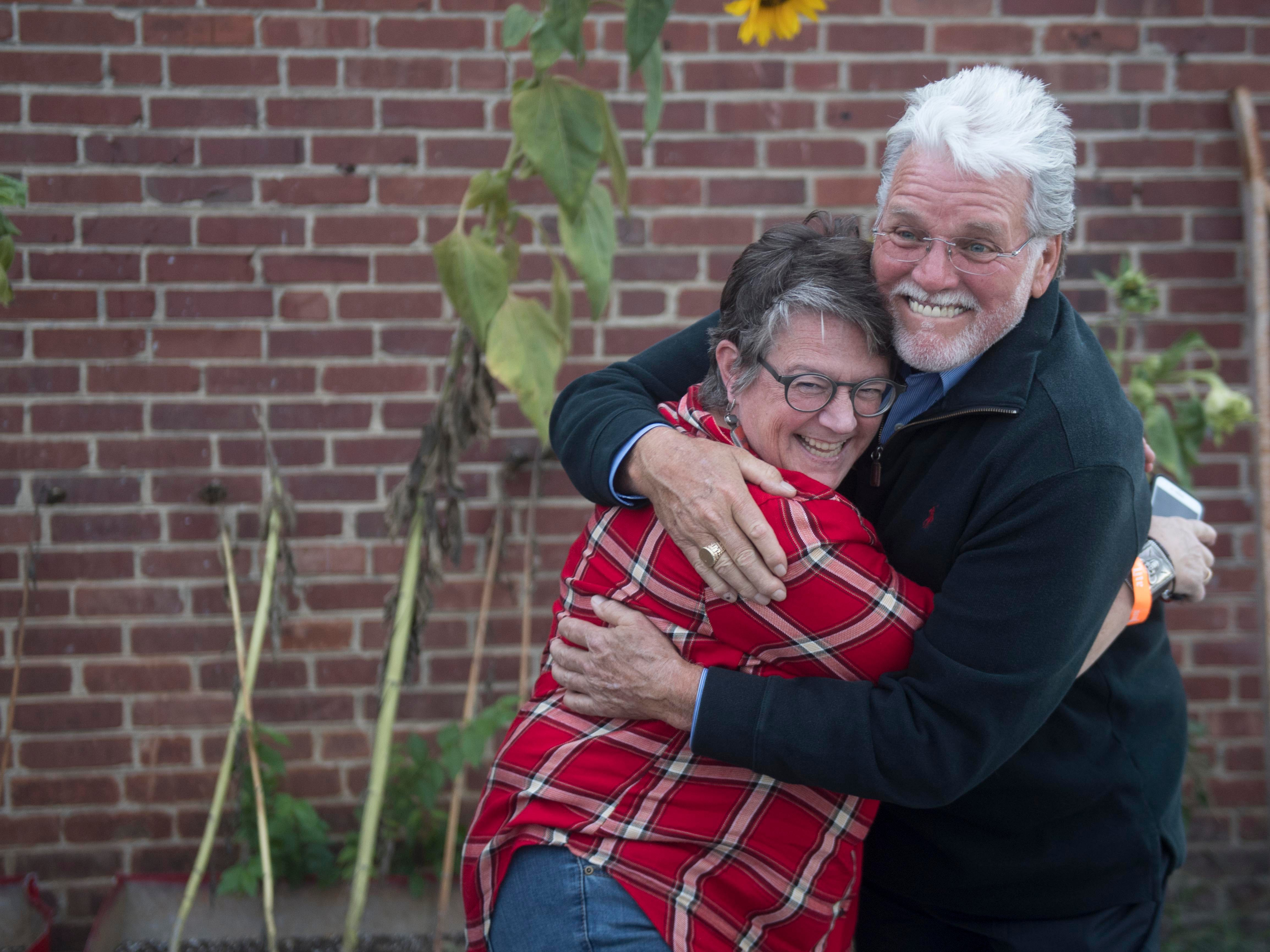 Con Hunley greets Holly Hambright before performing at The Corner Lounge on Friday, October 19, 2018.