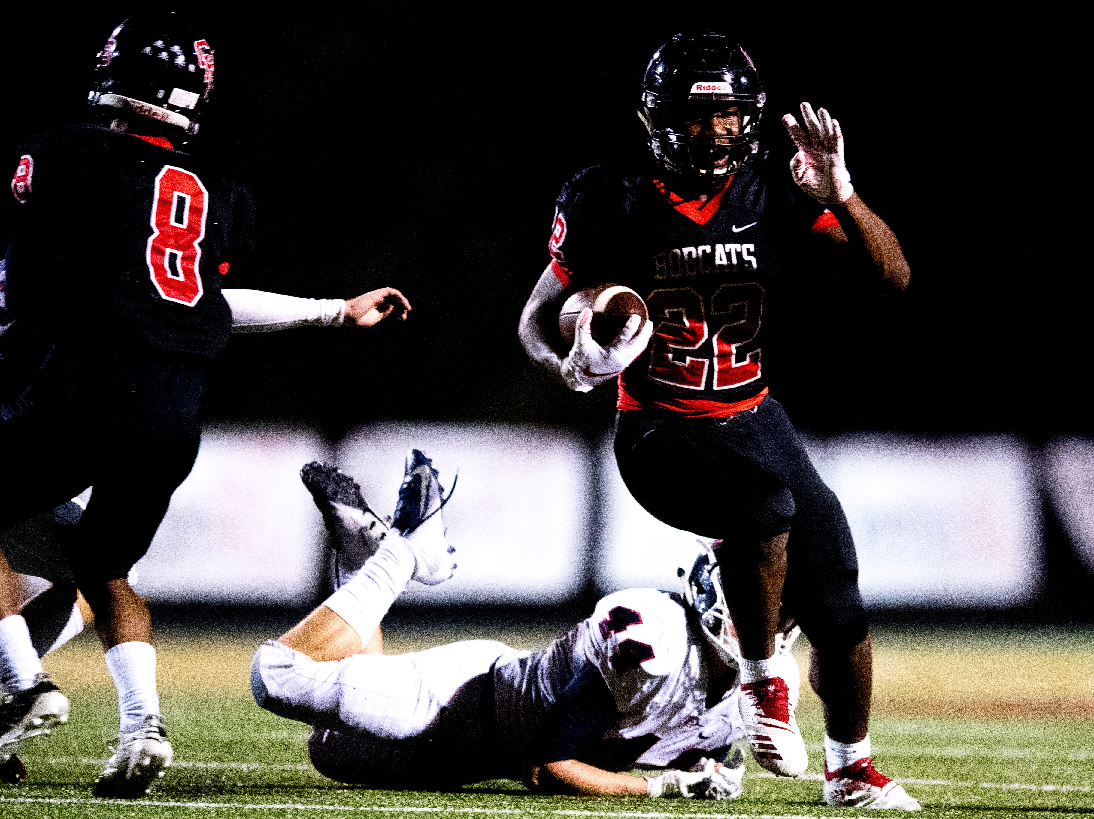 Central's Devone Moss (22) evades South-Doyle's Farrell Scott (44) during a football game between Central and South-Doyle at Central High School in Knoxville, Tennessee on Friday, October 19, 2018.