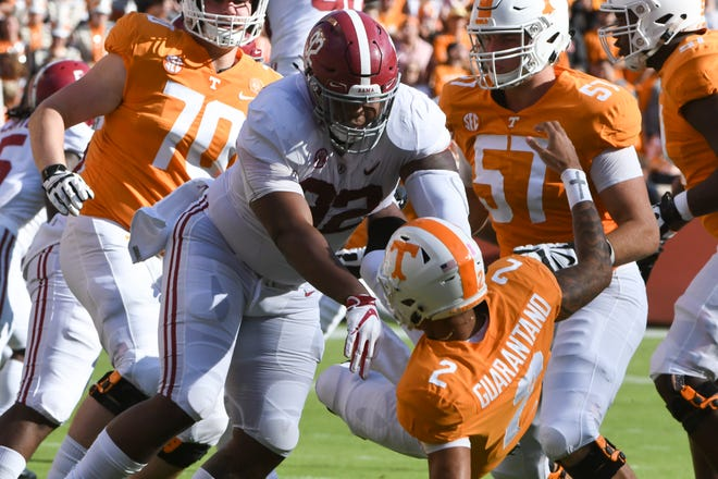 Alabama defensive lineman Quinnen Williams (92) pushes down Tennessee quarterback Jarrett Guarantano (2) during a game between Tennessee and Alabama at Neyland Stadium in Knoxville, Tennessee on Saturday, October 20, 2018.