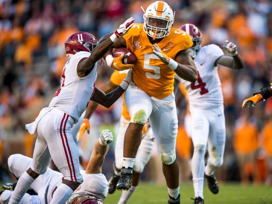 Tennessee defensive lineman Kyle Phillips (5) returns an interception for a touchdown during the Tennessee Volunteers' game against Alabama in Neyland Stadium on Saturday, October 20, 2018.