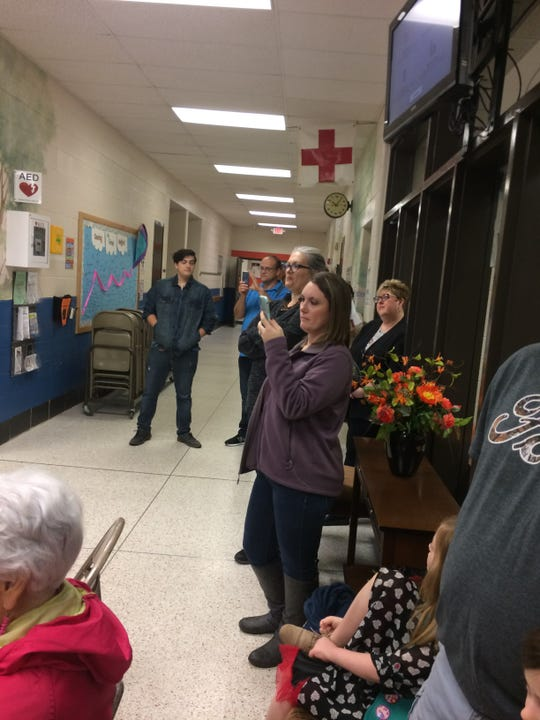 A crowd of about 30 people came to the re-dedication on a rainy Saturday morning.