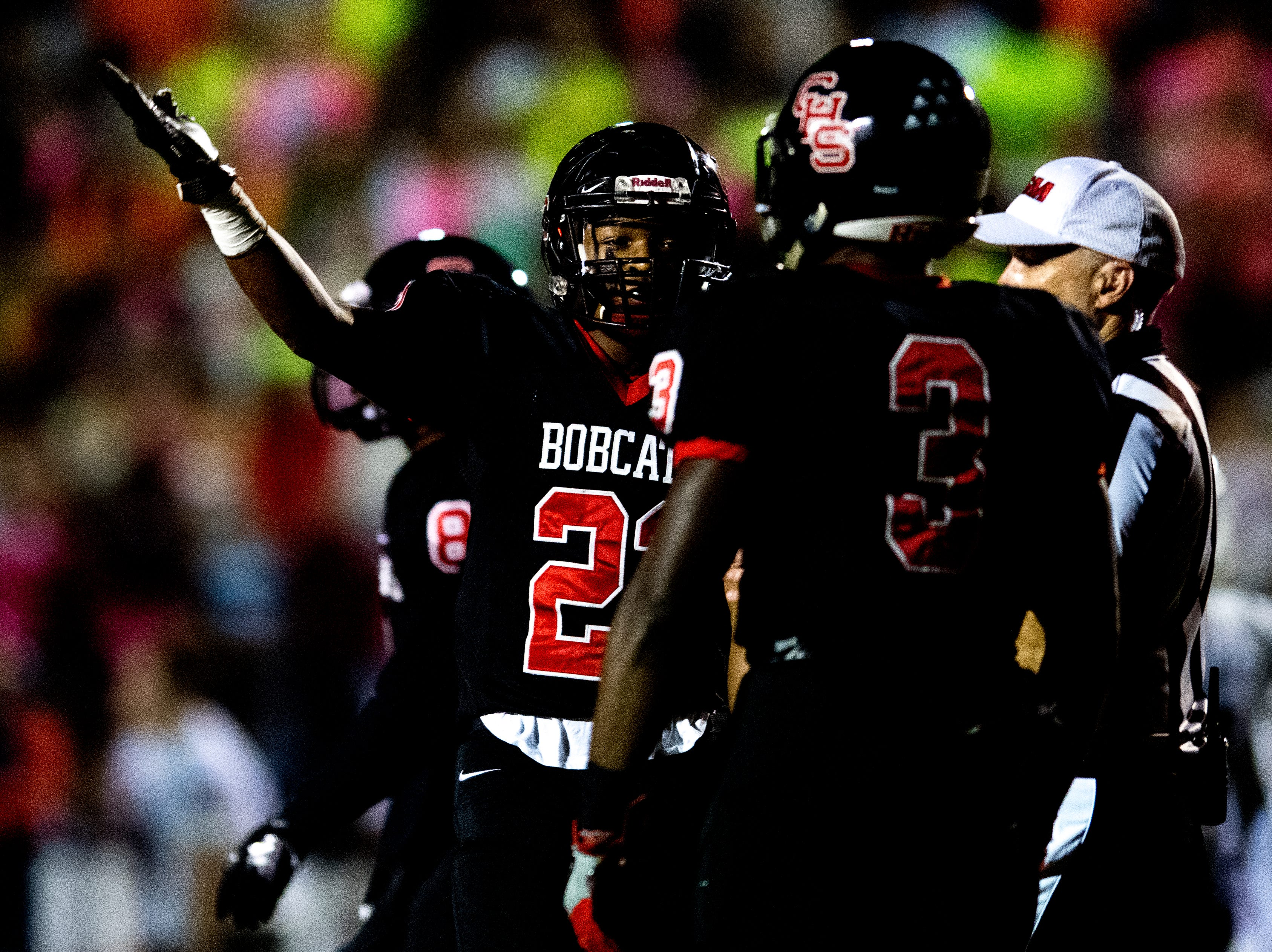 Central's Devone Moss (22) congratulates Xavier Washington (3) on his play during a football game between Central and South-Doyle at Central High School in Knoxville, Tennessee on Friday, October 19, 2018.