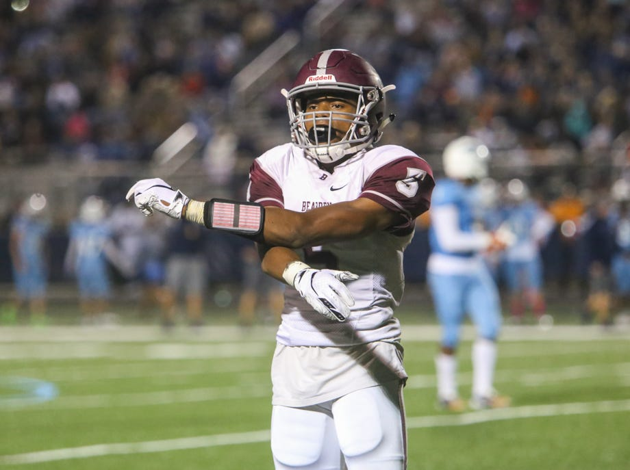Bearden's Kalil Abdullah (5) stretches in between plays during the Hardin Valley versus Bearden high school football game at Hardin Valley in Knoxville Friday Oct. 19, 2018.