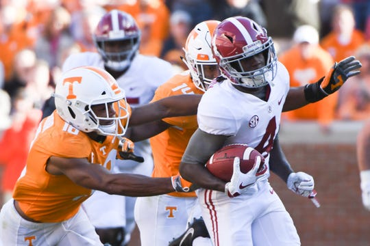 Alabama wide receiver Jerry Jeudy (4) runs down the field as Tennessee defensive back Nigel Warrior (18) goes for the tackle during a game between Tennessee and Alabama at Neyland Stadium in Knoxville, Tennessee on Saturday, October 20, 2018.