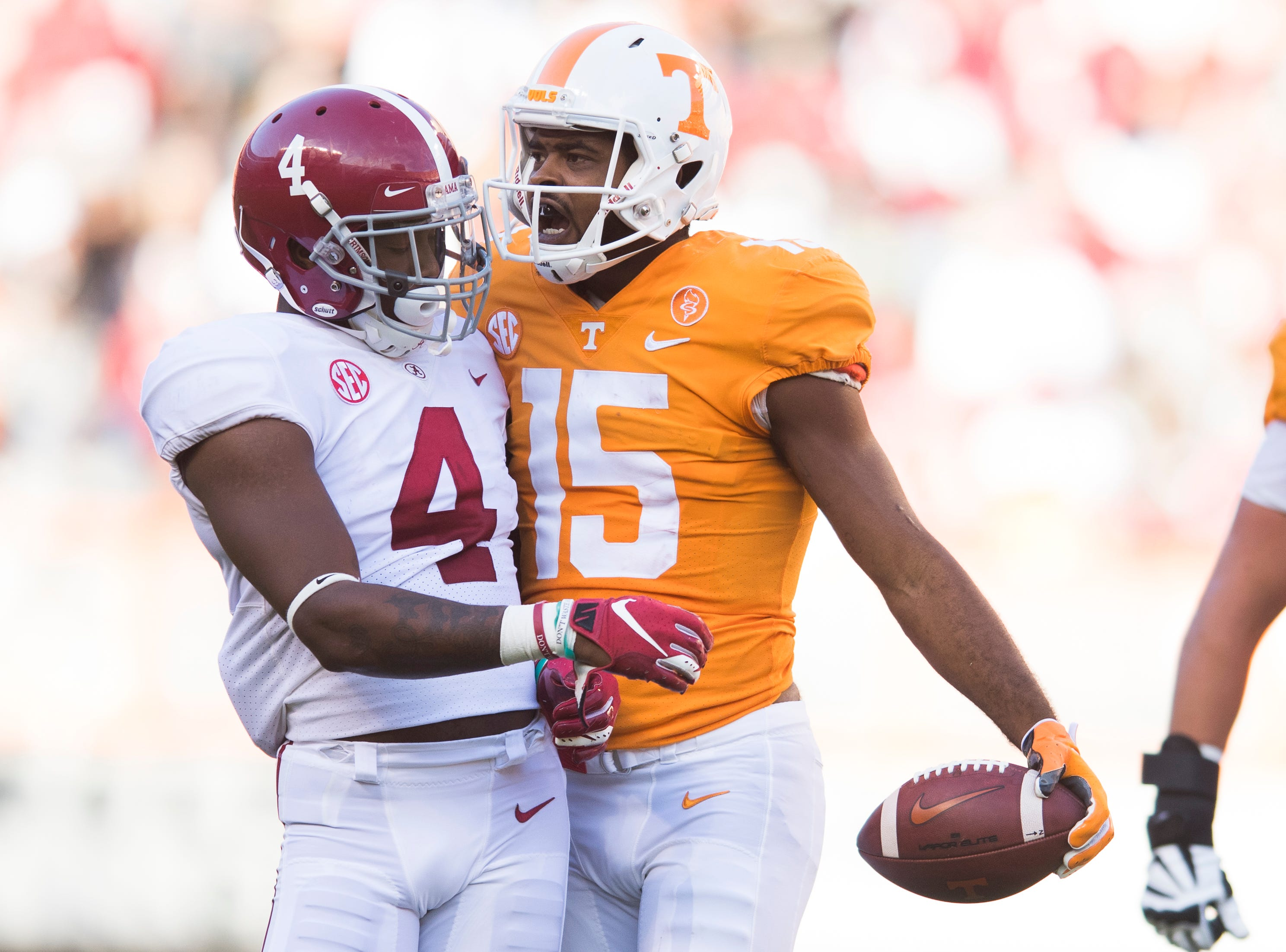 Tennessee wide receiver Jauan Jennings (15) bumps into  Alabama linebacker Christopher Allen (4) after making a play during a game between Tennessee and Alabama at Neyland Stadium in Knoxville, Tennessee on Saturday, October 20, 2018.