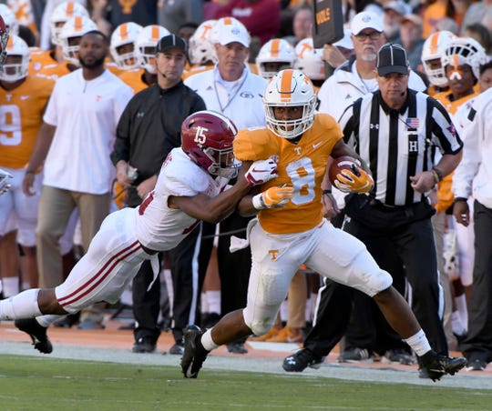 Tennessee running back Ty Chandler (8) is tackled by Alabama defensive back Xavier McKinney (15) during first half action Saturday, October 20, 2018 at Neyland Stadium in Knoxville, Tenn.