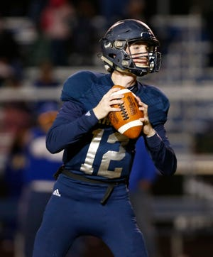 Central Catholic quarterback Wes Dulin looks for an open receiver against North White in the football sectional Friday, October 19, 2018, in Lafayette. CC defeated North White 50-0.