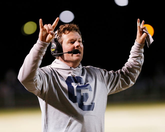 Central Catholic head coach Brian Nay shouts instructions to the Knights as they face North White in the football sectional Friday, October 19, 2018, in Lafayette. CC defeated North White 50-0.