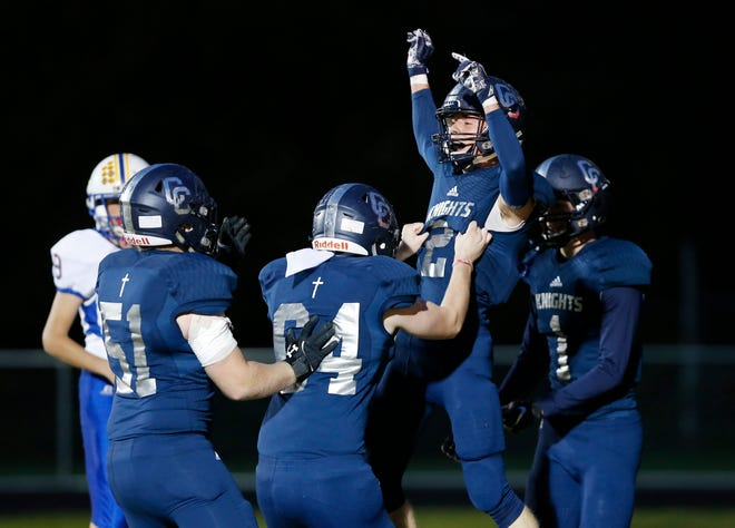 Scott Lovell of Central Catholic celebrates with teammates after his touchdown reception at 8:03 in the first quarter against North White in the football sectional Friday, October 19, 2018, in Lafayette. CC pounded North White 50-0.