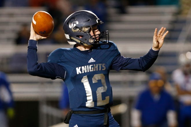 Central Catholic quarterback Wes Dulin with a pass in the first half against North White in the football sectional Friday, October 19, 2018, in Lafayette.