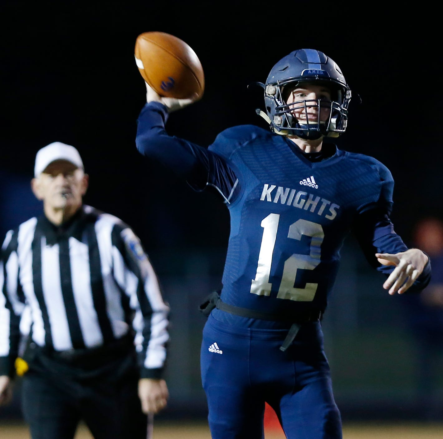 Central Catholic quarterback Wes Dulin with a pass in the first quarter against North White in the football sectional Friday, October 19, 2018, in Lafayette.