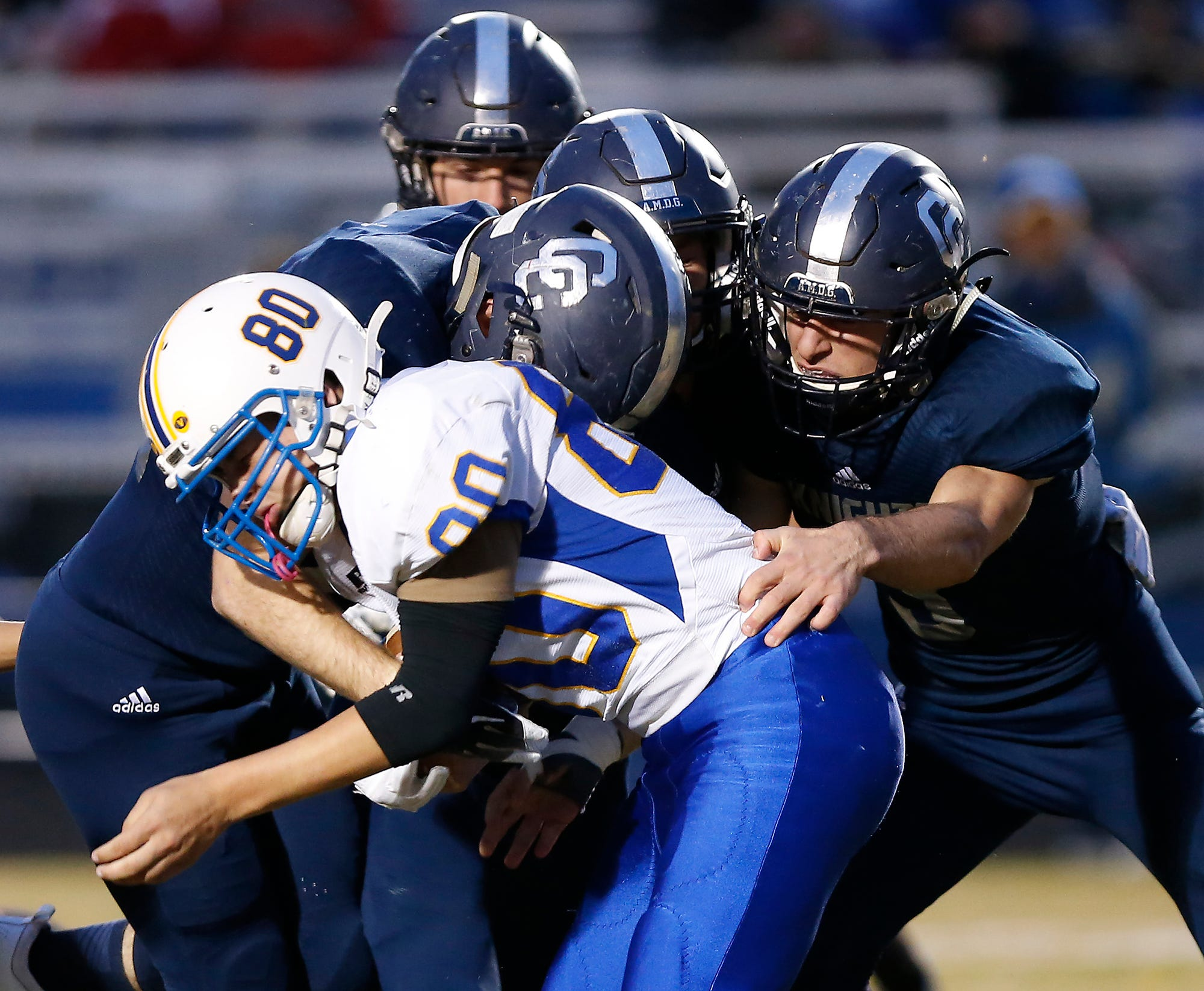 The Central Catholic defense wraps up Richie Spear of North White in the first half.