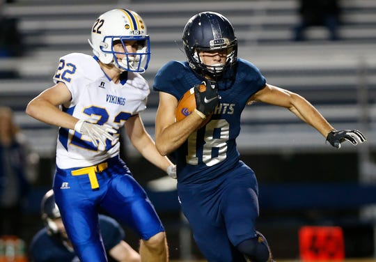 Karson Kyhnell of Central Catholic looks for running room after a pass reception against North White in the football sectional Friday, October 19, 2018, in Lafayette.