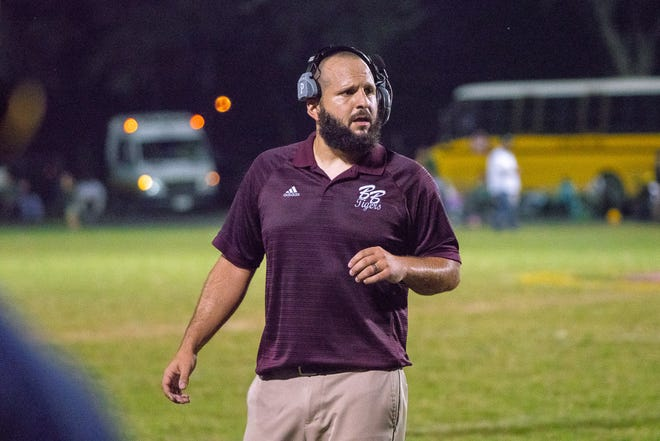 Breaux Bridge's head football coach Chad Pourciau observes his players on the field as the Cecilia Bulldogs take on the Breaux Bridge Tigers on October 19, 2018.