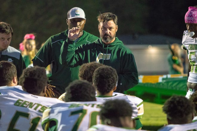 Crowley's head football coach Jeptha Wall talks to his players before the game as the Church Point Bears play at home against the Crowley Gents on October 18, 2018.