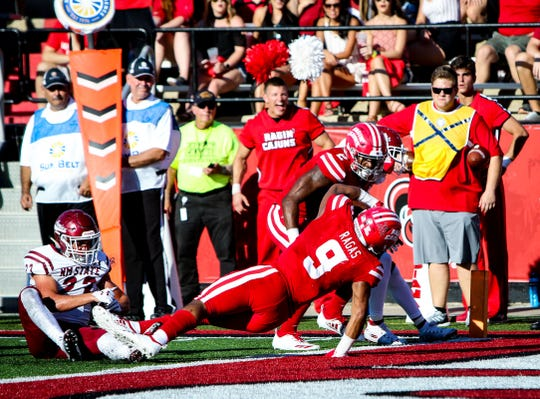 UL running back Trey Ragas fights for a touchdown during the Homecoming game Oct. 13 against New Mexico State at Cajun Field in Lafayette.