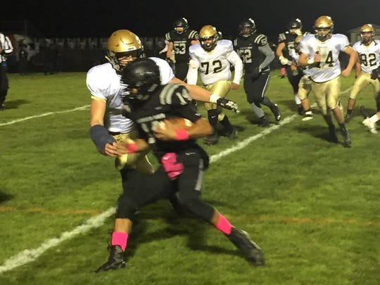 Lancaster's Owen Snyder tackles Pickerington North quarterback Mike Lowery during the Gales' 35-21 win.