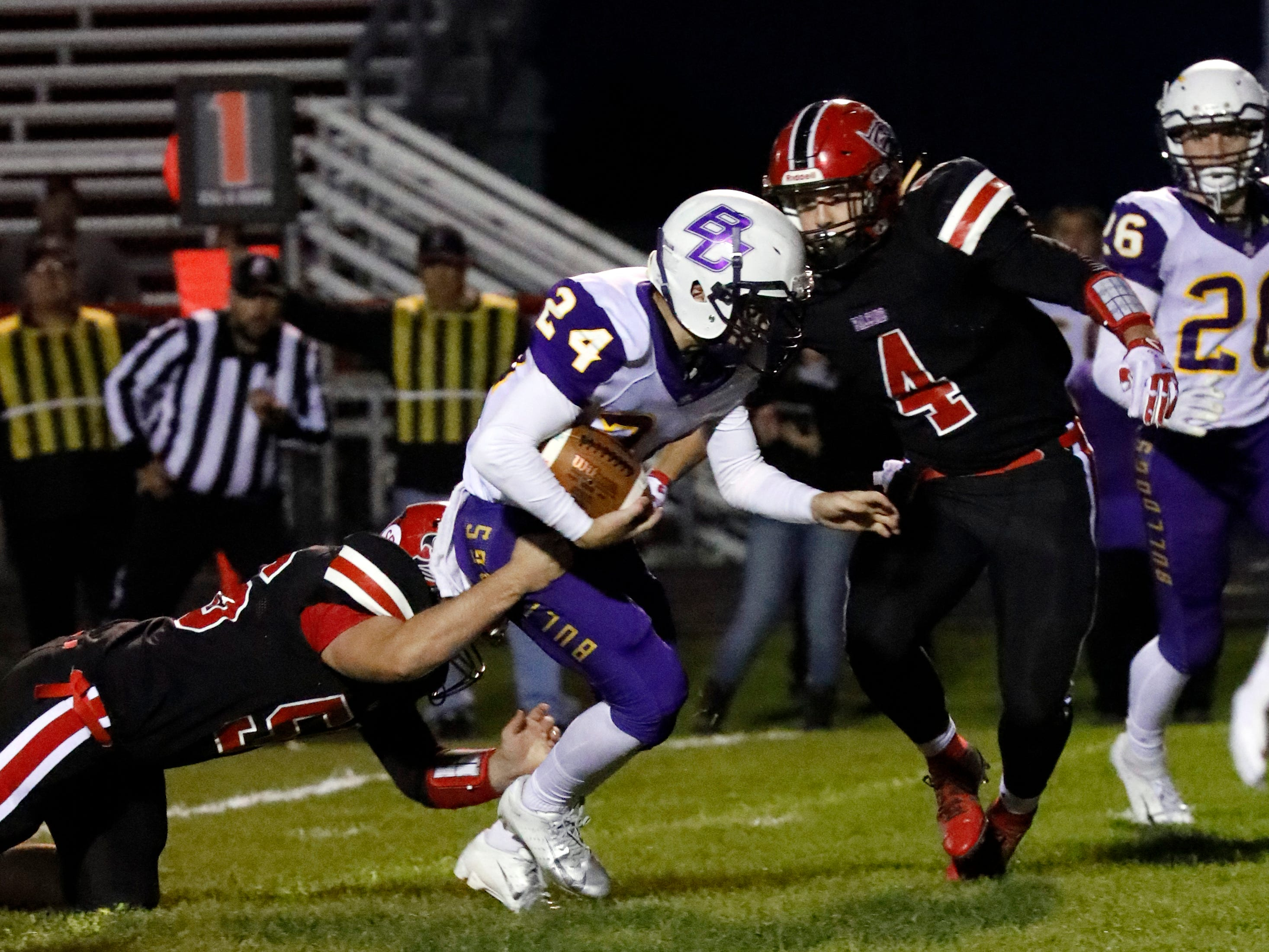 Bloom-Carroll's Evan Willet is tackled by Fairfield Union's Robert Wyeth and Johnny LaRock during Friday night's game, Oct. 19, 2018, at Fairfield Union High School in Rushville. The Bulldogs defeated the Falcons 44-7.