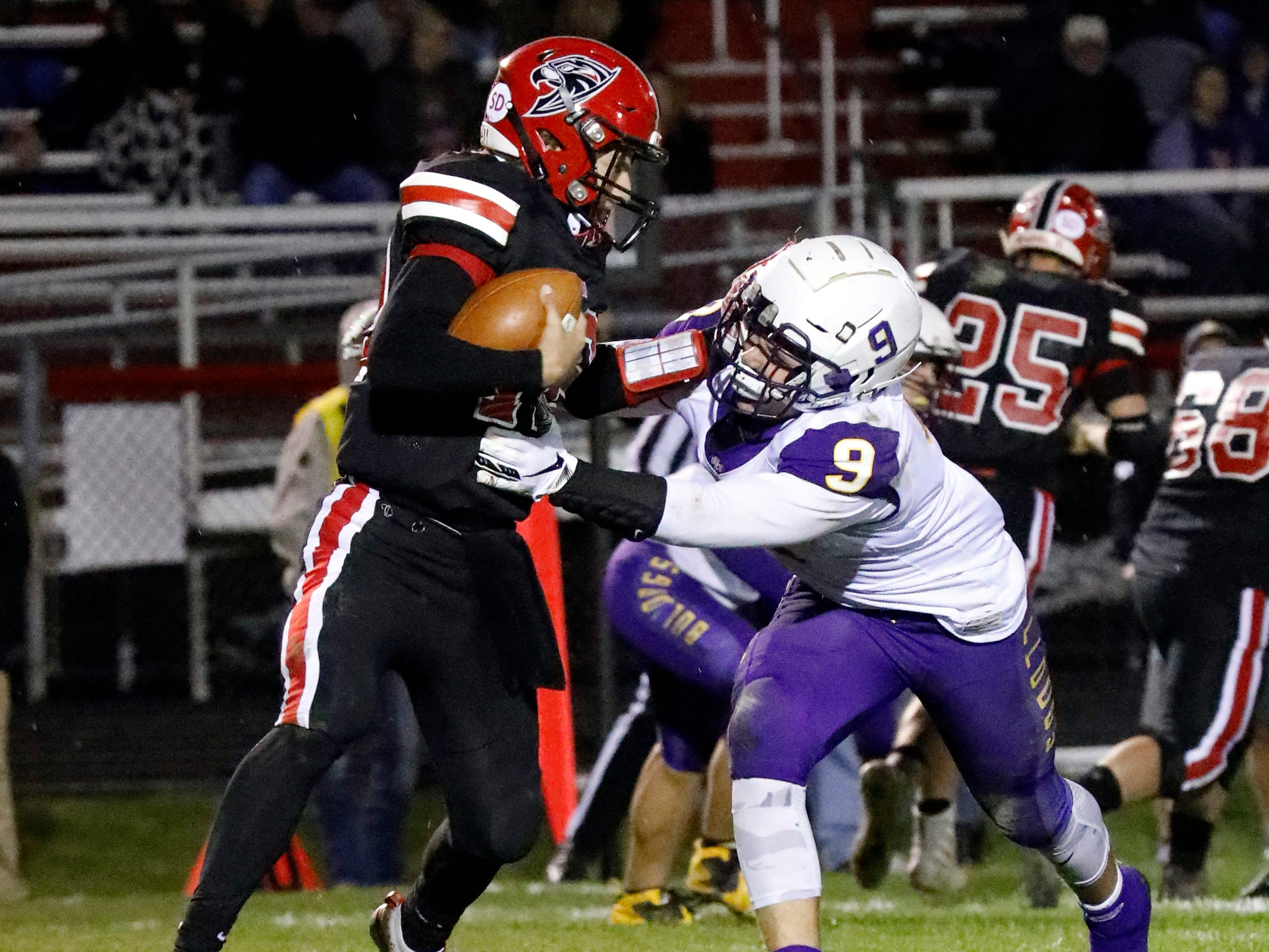 Fairfield Union quarterback Blayde Patton is sacked by Bloom-Carroll's Hobie Scarberry Friday night, Oct. 19, 2018, at Fairfield Union High School in Rushville. The Bulldogs defeated the Falcons 44-7.