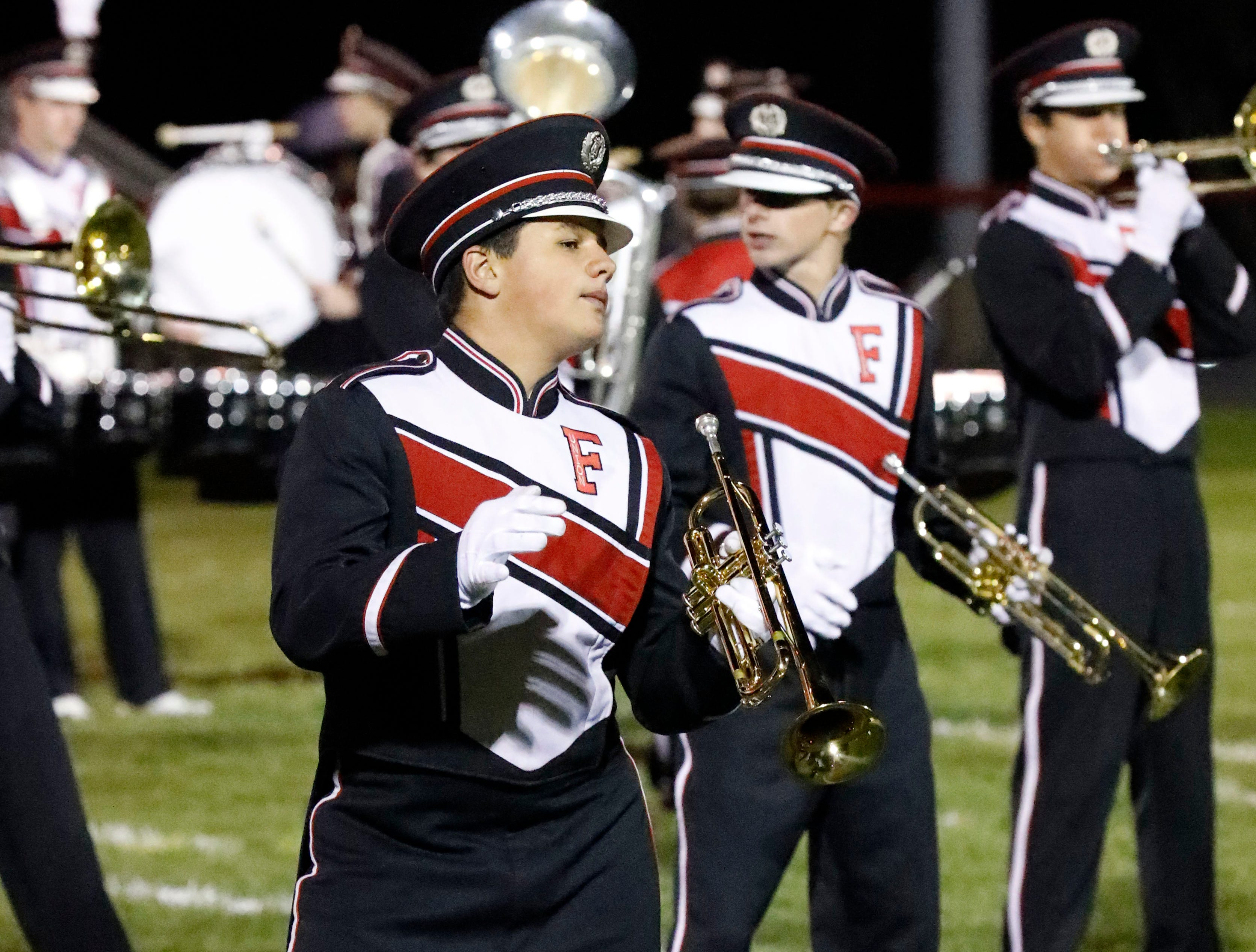 The Fairfield Union High School marching band perform during halftime at Friday night's football game, Oct. 19, 2018, at Fairfield Union High School in Rushville.