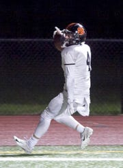 Nicholas Nemecek of Brighton celebrates a 3-yard touchdown run in a 32-17 loss at Belleville on Friday, Oct. 19, 2018.