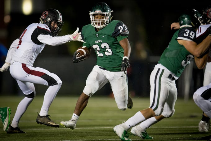 Trinity's running back Gereimah Smith (23) runs with the ball during the high school football game played against the Ballard in Louisville, Kentucky, Friday, October, 19, 2018