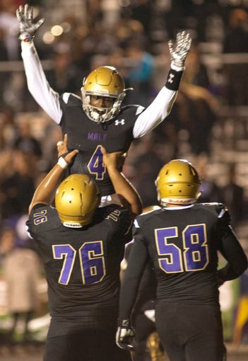 Male wide receiver Geremiah Edison is hoisted by Male offensive lineman Christopher Malala moment after Edison scored. Watching at right is Male offensive lineman Nathan Stotts. October 19, 2018