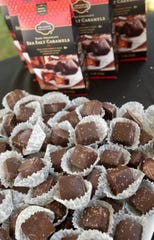 Kroger offers a taste of their sea salt caramels to guests at the Courier-Journal Wine and Food Experience at Norton Commons. October 20, 2018