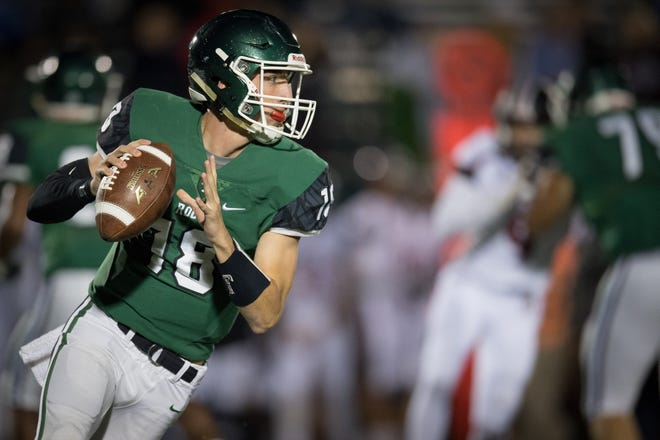 Trinity's quarterback Seth Jutz (18) scrambles with the ball during the high school football game played against the Ballard in Louisville, Kentucky, Friday, October, 19, 2018
