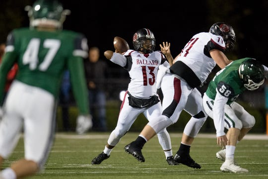 Ballard's quarterback Larry Cummings (13) prepares to throw the ball during the high school football game played against the Trinity in Louisville, Kentucky, Friday, October, 19, 2018