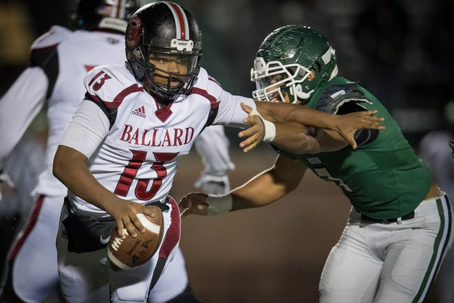 Ballard's quarterback Larry Cummings (13) scrambles with the ball during the high school football game played against the Trinity in Louisville, Kentucky, Friday, October, 19, 2018