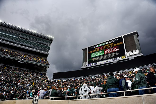 Storm clouds moved over Spartan Stadium early Saturday afternoon after fans were told over the loudspeaker to evacuate during an extreme weather delay in the first quarter of Michigan State's game against Michigan. The delay lasted a little over an hour.