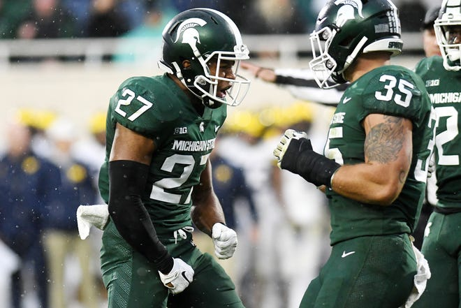 Michigan State's Khari Willis, left, celebrates after breaking up a pass during the third quarter on Saturday, Oct. 20, 2018, in East Lansing.