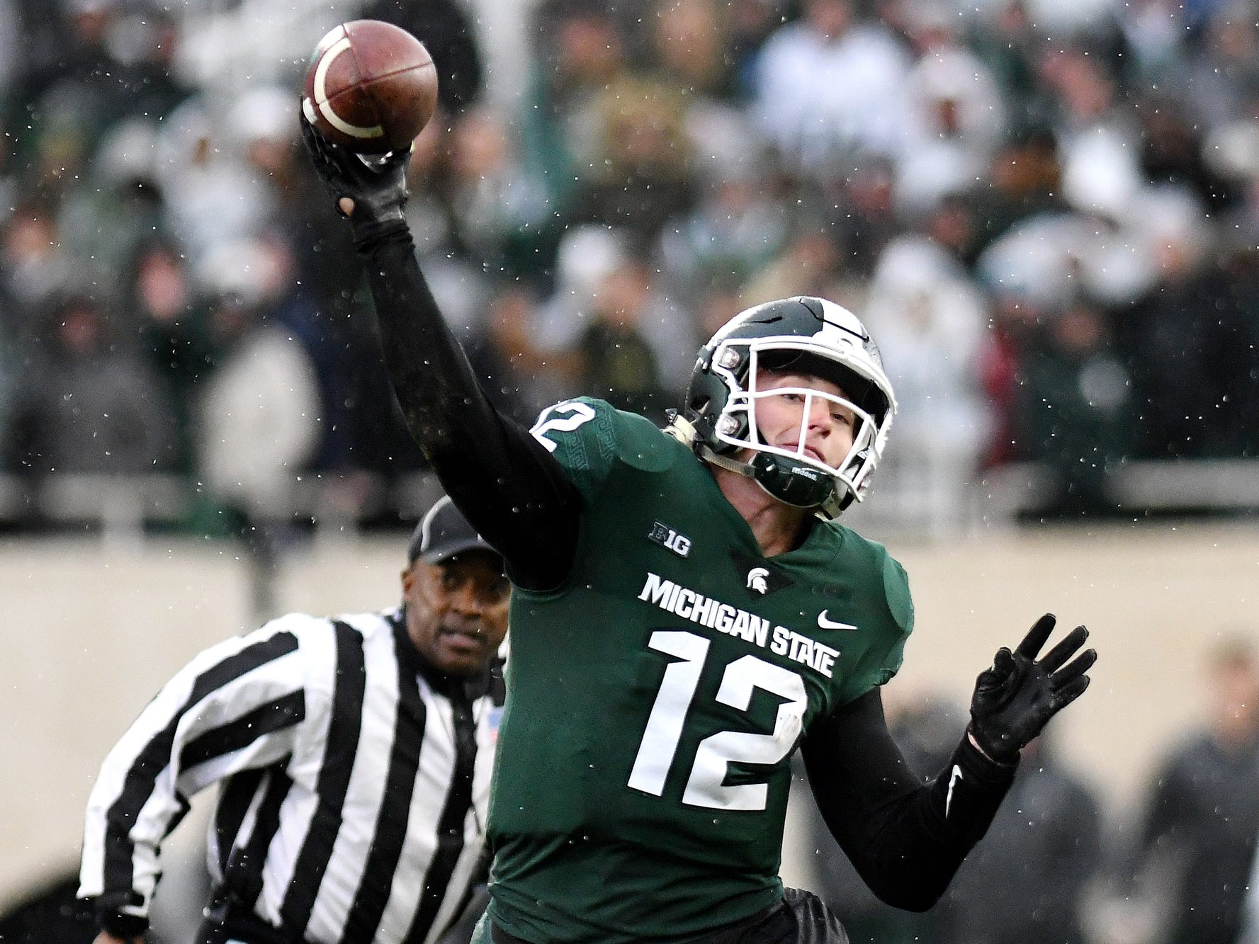 Michigan State's Rocky Lombardi throws a pass during the fourth quarter on Saturday, Oct. 20, 2018, in East Lansing.