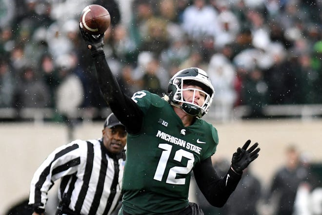 Michigan State QB Rocky Lombardi throws a pass on the final drive against Michigan last weekend.