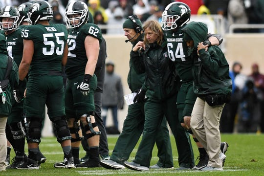 Michigan State center Matt Allen (64) missed three games last season after getting hurt Oct. 20 against Michigan. The Spartans lost 19 starts from five different offensive linemen in 2018.