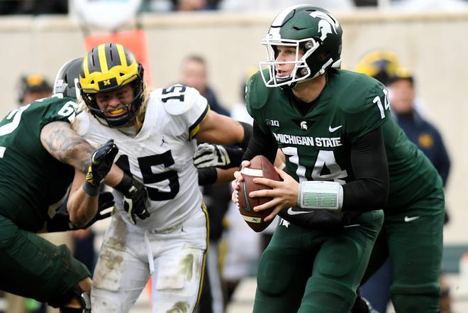 Michigan State's Brian Lewerke looks to throw during the fourth quarter on Saturday, Oct. 20, 2018, in East Lansing.