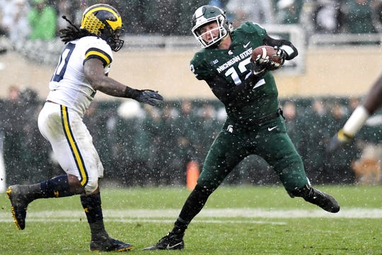 Michigan State's quarterback Rocky Lombardi, right, is pressured by Michigan's Devin Bush during the fourth quarter on Saturday, Oct. 20, 2018, in East Lansing. Lombardi was sacked on the play.