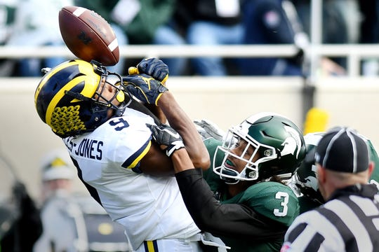 Michigan State's Xavier Henderson, right, breaks up a deep pass to Michigan's Donovan Peoples-Jones during the second quarter on Saturday, Oct. 20, 2018, in East Lansing.