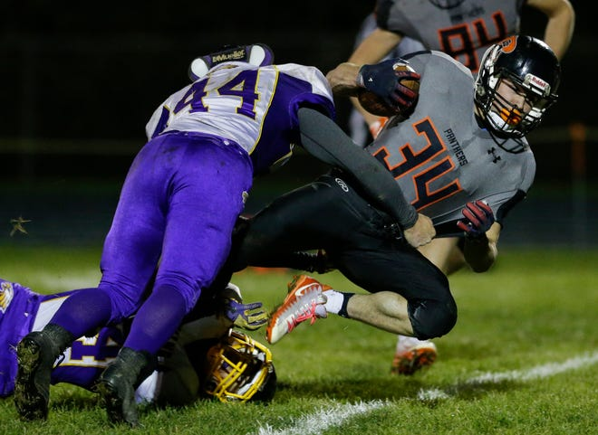 Reedsville's Brandon Stelzer runs for a big gain to set up a touchdown against Suring during the first quarter of a WIAA Division 7 playoff game Friday at Reedsville.
