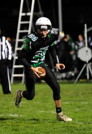 Clear Fork's Brennan South looks for an opening to make a pass while playing against Marion Pleasant in Week 9.