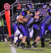 Lexington's Cade Stover looks for running room in the first half of Friday's 42-16 win over Madison.