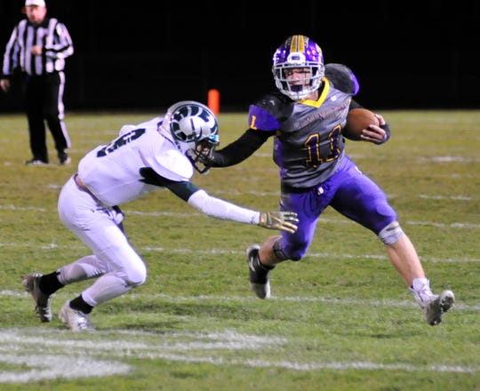 Lexington's Kayden Berry holds off a Madison player last season. In Week 1, Berry broke Brad Gallik's 2007 single-game rushing record with 296 yards.