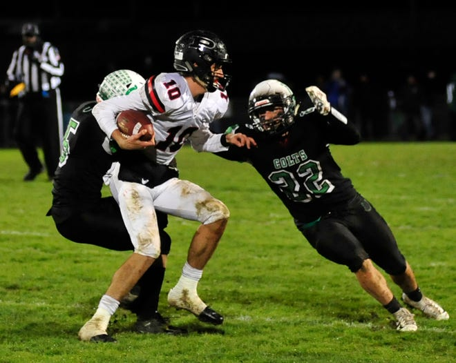 Clear Fork's Jay Swainhart tackles a Marion Pleasant's Ethan Warner in Week 9.