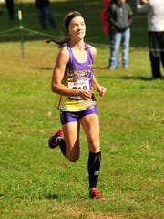 Lexington's Joanna Halfhill crosses the finish line during the Cross Country District Tournament at Galion on Saturday.