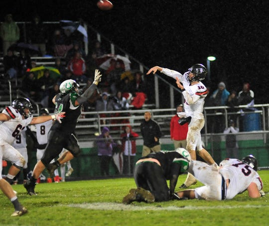 Marion Pleasant's Ethan Warner throws a pass while at Clear Fork on Friday.