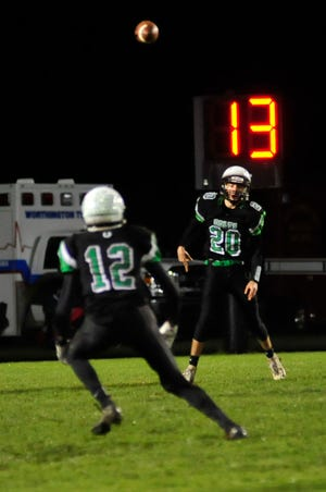 Clear Fork's Brennan South throws a pass to AJ Blubaugh while playing against Marion Pleasant on Friday.