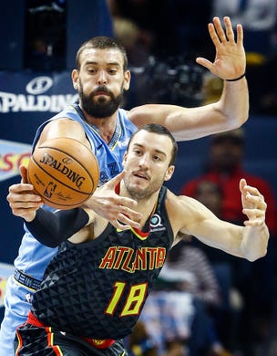 Memphis Grizzlies defender Marc Gasol (back) guards  Atlanta Hawks forward Miles Plumlee (front) during action of their home-opener at the FedExForum in Memphis, Tenn., Friday, October 19, 2018.
