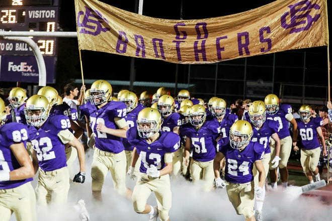 October 19 2018 - The Christian Brothers football team takes the field before the start of Friday night's game versus Wooddale at Christian Brothers High School.